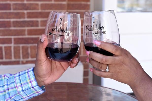 Engaged couple making a toast